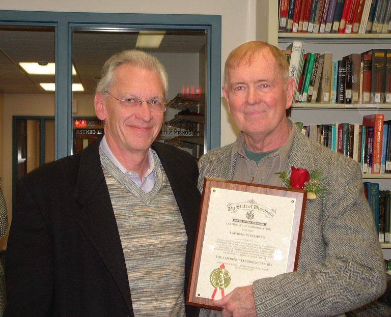 UW–Madison Chancellor John Wiley (left) stands beside Larry Jacobsen in December 2005, when Larry was awarded a Certificate of Commendation from the State of Wisconsin Office of the Governor for developing Primate Info Net as an internationally recognized resource for primate education and conservation. As part of the honor, the WNPRC library was renamed the Lawrence Jacobsen Library. (Photo by Edi Chan)